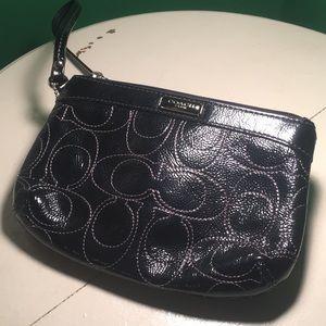 Coach black patent leather clutch